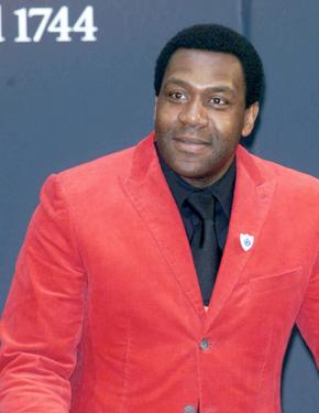 "Lenny Henry at the Robbie Williams memorabilia Auction for comic relief and ""Give It Sum."""